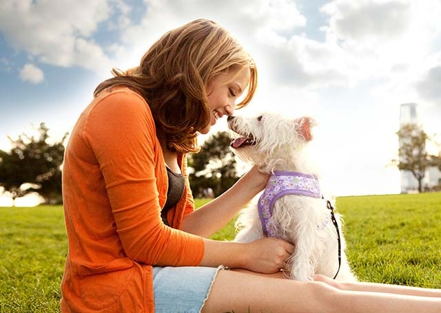 woman loving dog